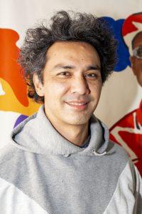 Hisham smiling